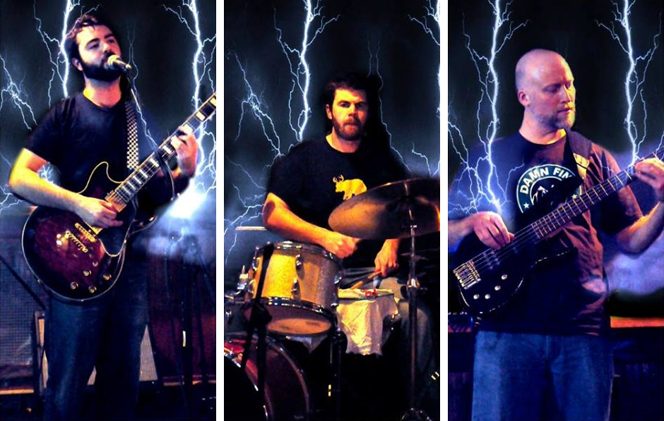 Photo of the band with lightning bolts around them